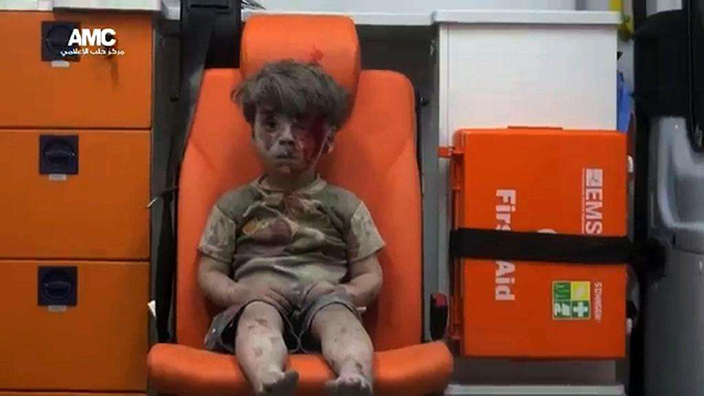 This haunting photo of a young Syrian boy in an ambulance, who was pulled from the rubble after an air strike in Aleppo, has captured the world's attention (AFP Photo/)