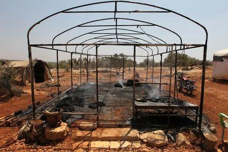 A burnt tent for displaced people is pictured after airstrikes on the outskirts of the rebel-held town of Atareb in Aleppo province