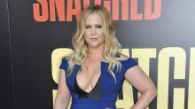 Amy Schumer overcome with emotion as wheelchair-bound father stands