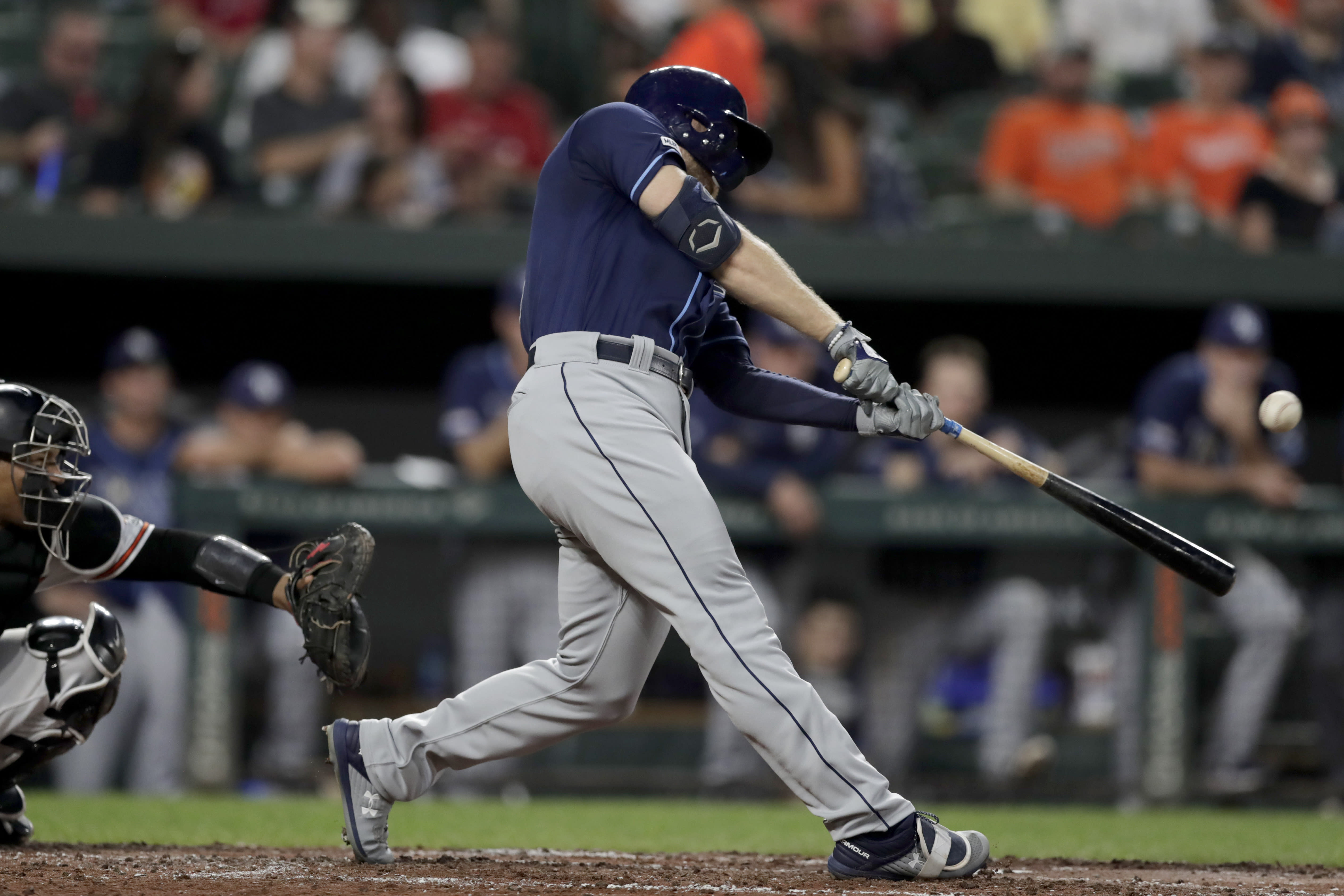 Tampa Bay Rays' Austin Meadows hits a solo home run off Baltimore Orioles starting pitcher Asher Wojciechowski during the third inning of a baseball game Thursday, Aug. 22, 2019, in Baltimore. (AP Photo/Julio Cortez)