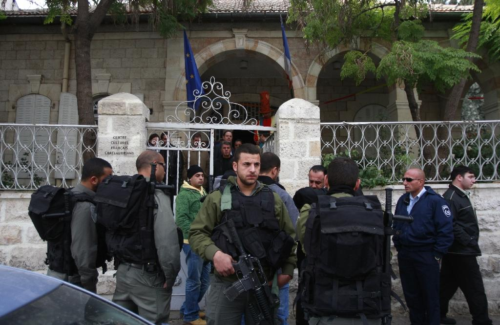 Israeli border police surround the entrance of the French cultural centre in annexed east Jerusalem during a previous diplomatic spat over an event it hosted in 2009