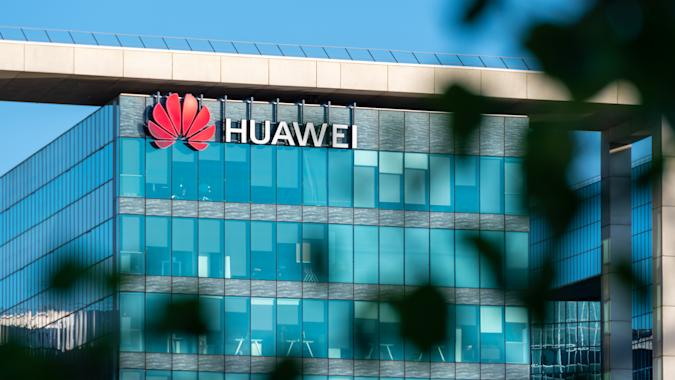 Boulogne-Billancourt, France - June 6, 2020: French headquarters of Huawei Technologies, chinese multinational company which designs, develops, and sells telecommunications equipment and smartphones. Blurred foliage in the foreground