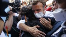 In devastated Beirut, French leader offers comfort and a hug