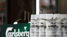 Carlsberg suspends outlook as locked-down drinkers opt for cheaper beers