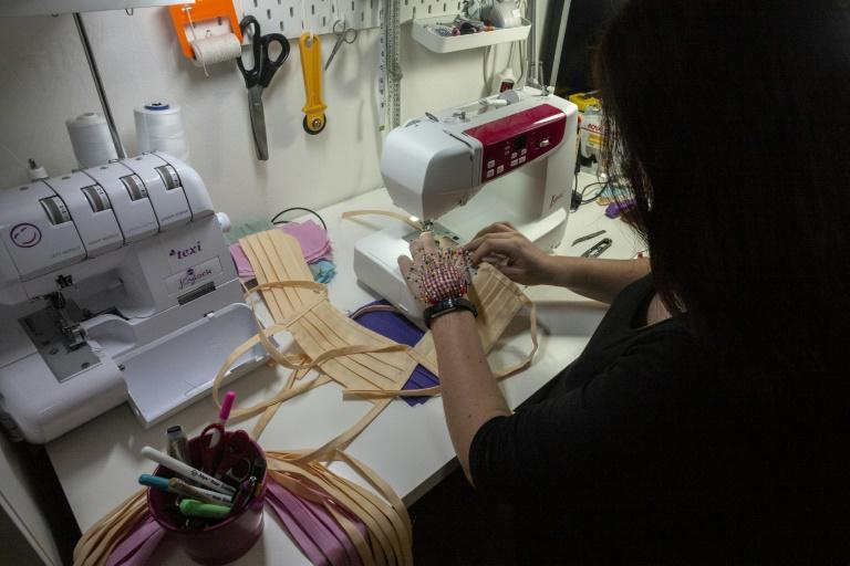 Thousands of Czech women are sewing face masks to help combat the spread of the coronavirus (AFP Photo/Michal Cizek)
