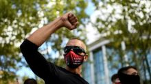 Virus curbs rile Europeans as global deaths near one million
