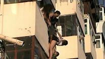 Raw: Woman Safe After Dangling From Balcony