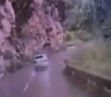 Volkswagen crushed by boulder on mountain road in southwest China