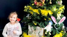 Parents are cheering up their kids by digging out their Christmas trees for them to decorate for Easter