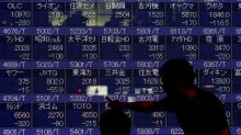 Global equities fall after Fed keeps rates on hold, dollar up