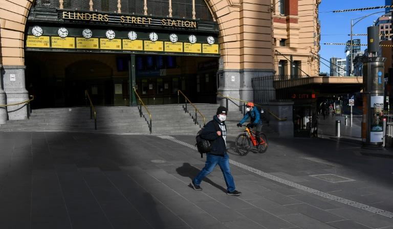 The Flinders Street Station in Melbourne was nearly deserted on August 3, 2020 after new lockdown measures to fight the spread of the novel coronavirus (AFP Photo/William WEST)