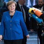 Germany's SPD vote to enter formal coalition talks with Angela Merkel's party