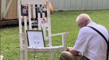 Photo of elderly man sitting with late wife's memorial at wedding goes viral