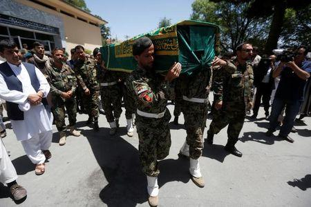 Afghan National Army (ANA) soldiers carry the coffin of Zabihullah Tamanna, an Afghan journalist who was killed alongside his colleague, NPR photojournalist David Gilkey, while embedded with local troops in Helmand province on Sunday, at a hospital in Kabul, Afghanistan June 7, 2016. REUTERS/ Omar Sobhani