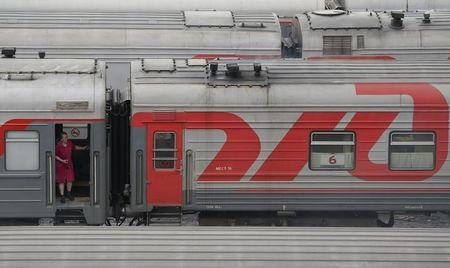 An employee looks out of a train carriage on the side tracks in Moscow
