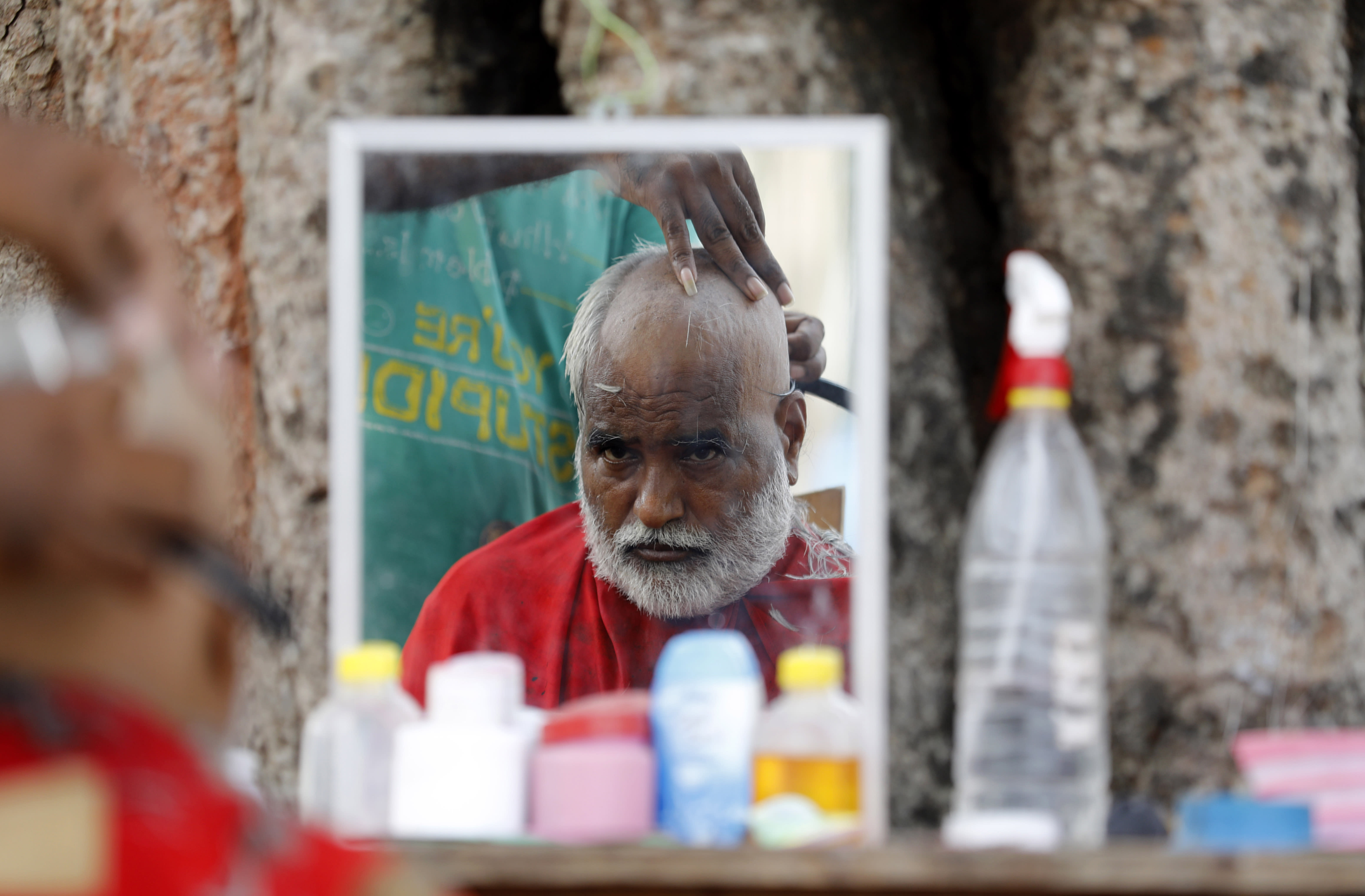 """A Hindu devotee gets a tonsure to perform """"Pind Daan"""" rituals at Sangam in Prayagraj in the northern Indian state of Uttar Pradesh India, Wednesday, Sept. 16, 2020. Pind Daan rituals are performed to bring peace and salvation to the souls of deceased ancestors. (AP Photo/Rajesh Kumar Singh)"""