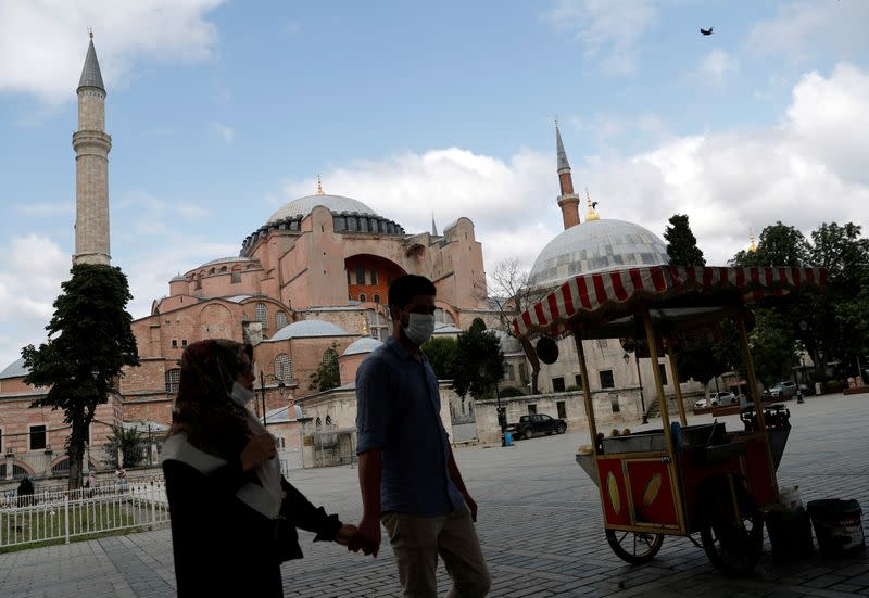 FILE PHOTO: People walk past Hagia Sophia, or Ayasofya, in Istanbul