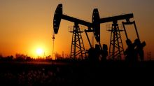 Oil prices fall but hold near three-month high on trade deal agreement