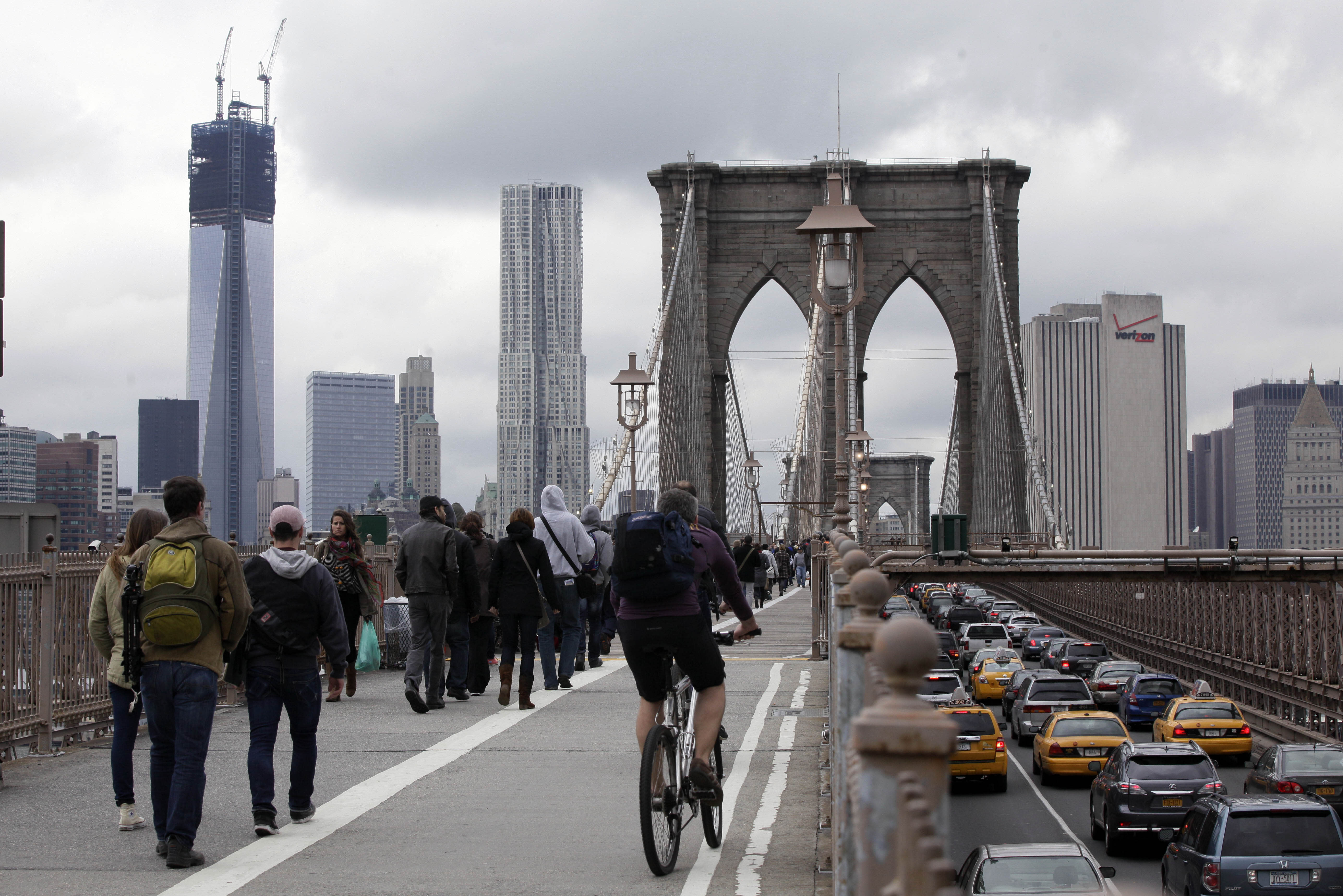 Commuters cross New York's Brooklyn Bridge, Wednesday, Oct. 31, 2012. The floodwaters that poured into New York's deepest subway tunnels may pose the biggest obstacle to the city's recovery from the worst natural disaster in the transit system's 108-year history. (AP Photo/Richard Drew)