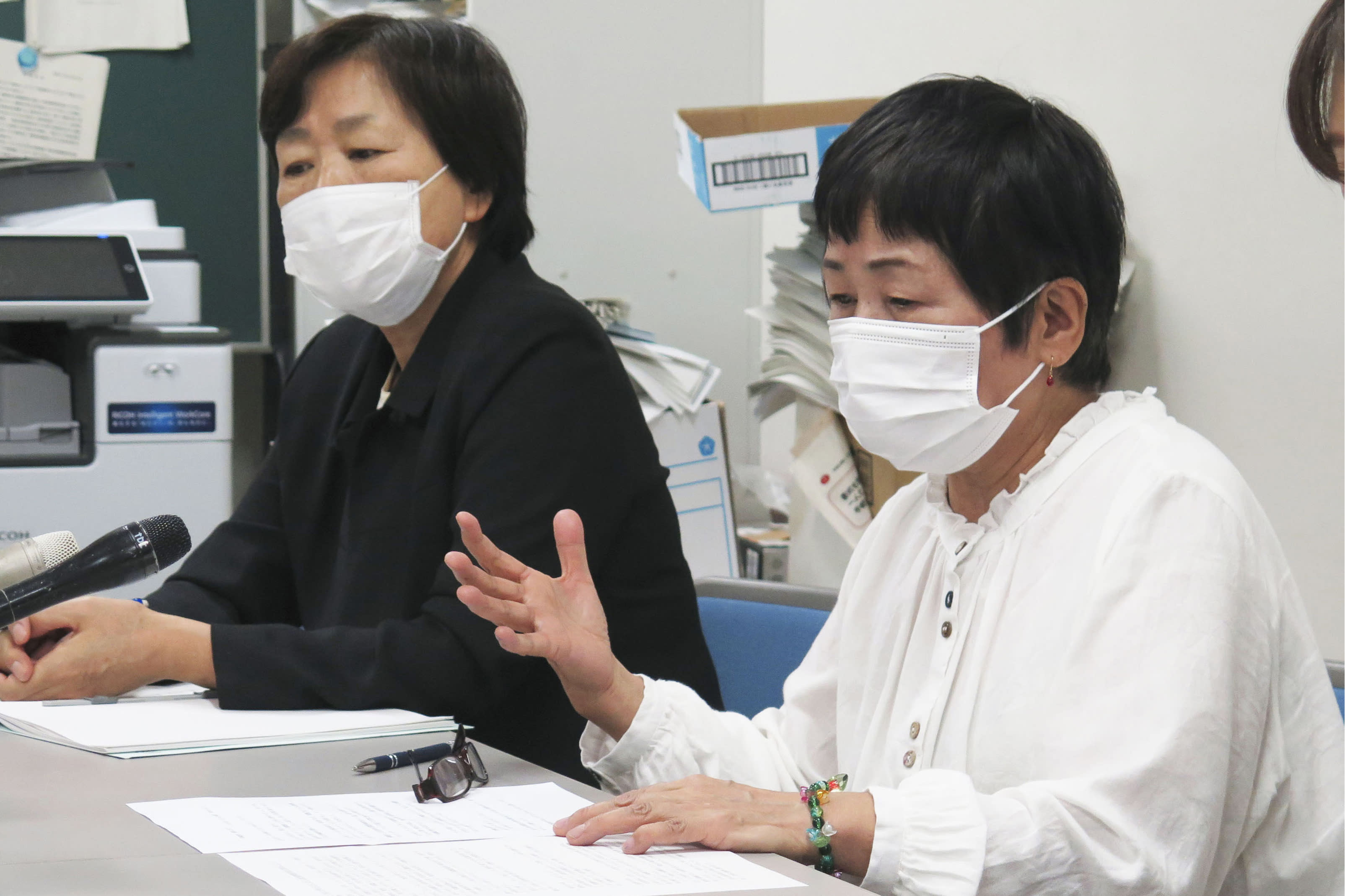 Harumi Suzuki, right, speaks during a press conference in Sendai, northern Japan, Thursday, Sept. 24, 2020. Suzuki has filed a suit against the Roman Catholic Church in Japan alleging that a priest raped her four decades ago, as the church's unfolding worldwide sexual abuse crisis gradually reaches Japan. (Kyodo News via AP)