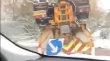 That's not supposed to happen! Driver captures road gritter on its roof