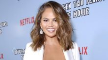 Chrissy Teigen reveals she is having her breast implants removed following criticism over coronavirus test