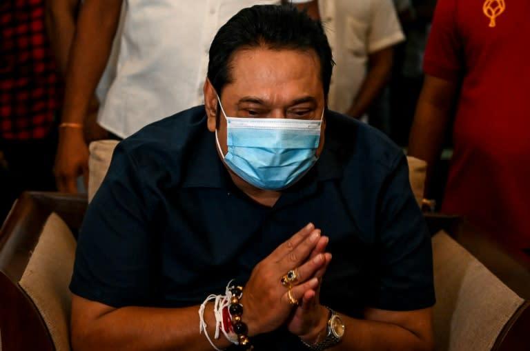Sri Lanka's Prime Minister Mahinda Rajapaksa greeted supporters at his home