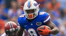 Florida suspends 7 players for Michigan game