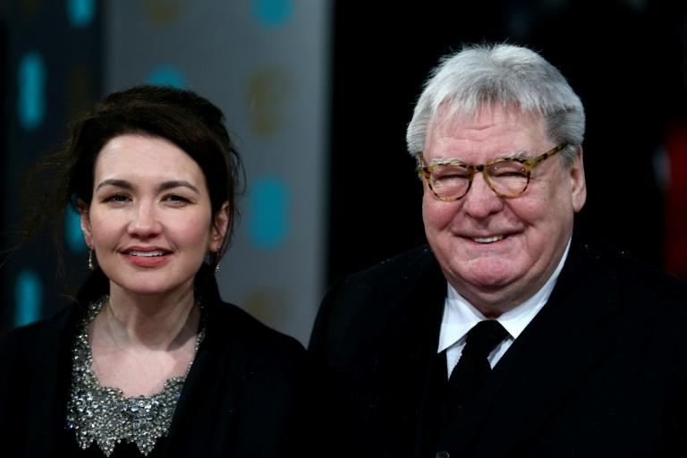 Parker with his wife Lisa on the red carpet at the BAFTA film Awards in London in 2013 (AFP Photo/ANDREW COWIE)