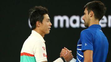 Nishikori retirement sees Djokovic through to semi-finals