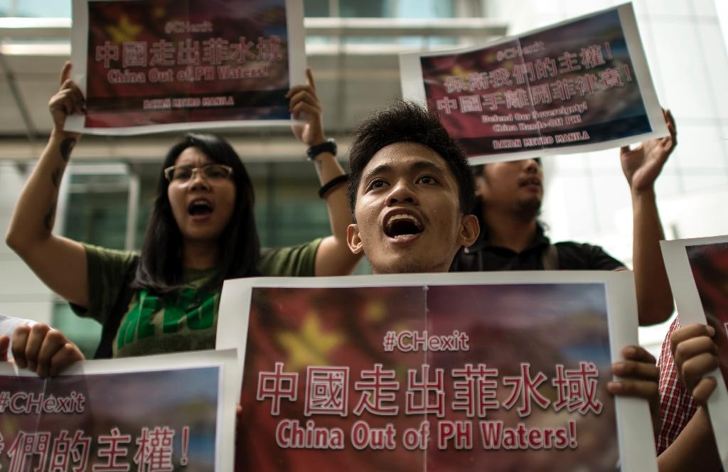 Philippine activists shout anti-China slogans during a protest in front of the Chinese consulate in Manila, on July 11, 2016