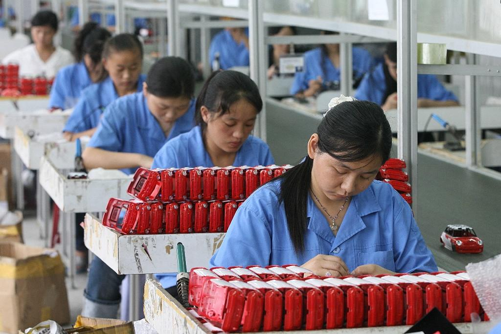 Workers assembling toys on a production line at a factory in Shantou, in China's eastern Guangdong province (AFP Photo/AFP)