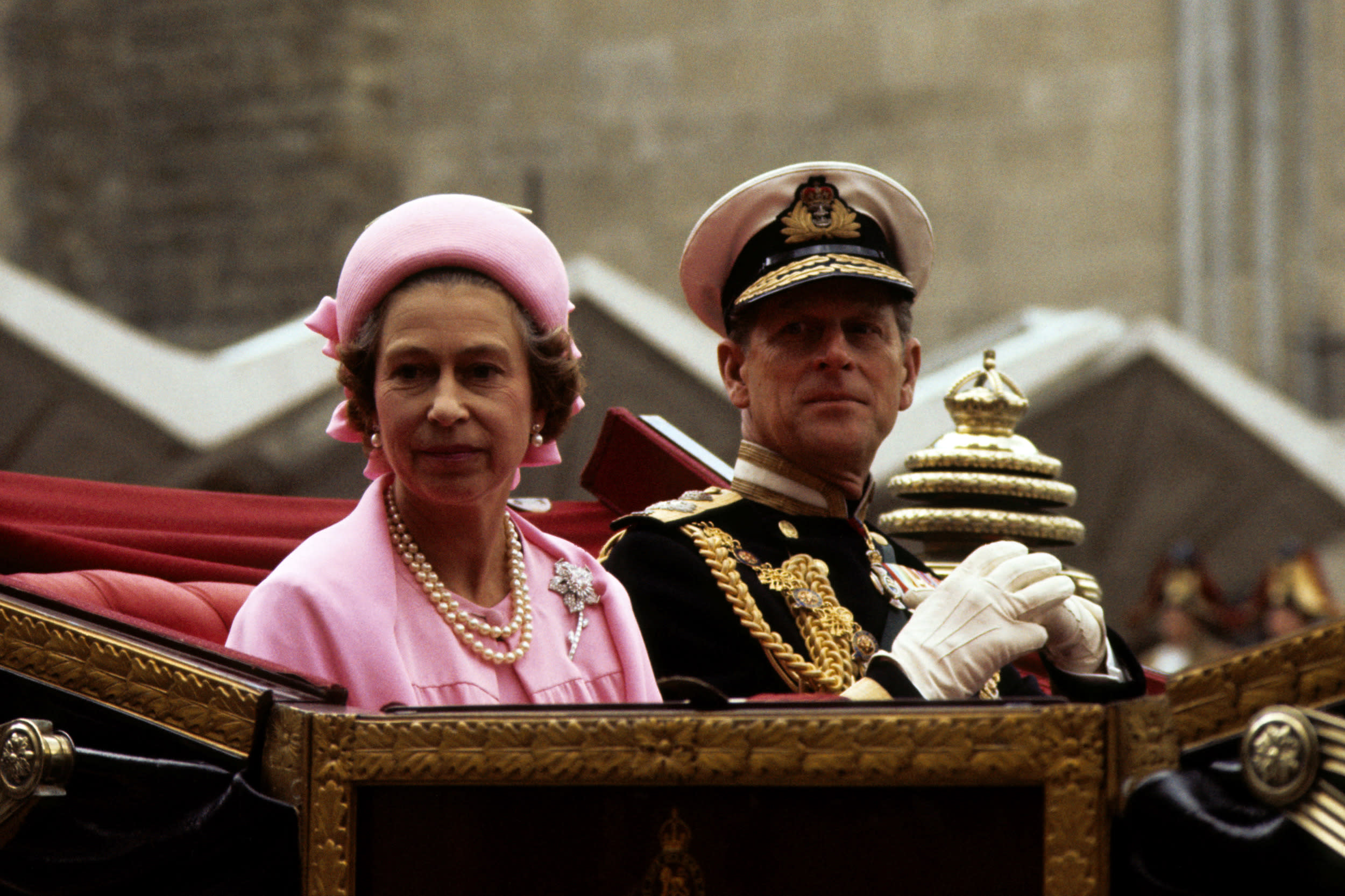 Queen Elizabeth II and the Duke of Edinburgh in the open landau as they drive on the return processional drive to Buckingham Palace after lunch at the Guildhall to celebrate the Silver Jubilee.