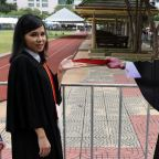 Thai students pose with 'dissidents' in graduation protest