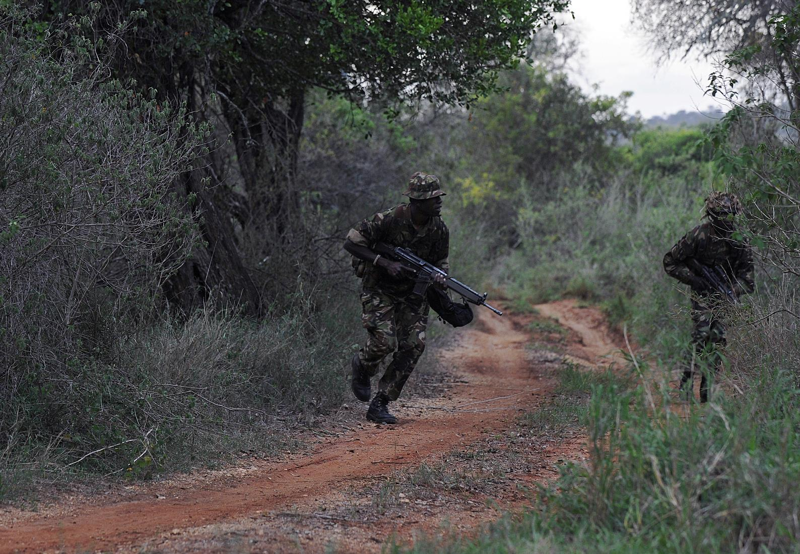 Members of an elite ranger team during a patrol at the Ol Jogi rhino sanctuary in Nairobi on August 6, 2014 (AFP Photo/Tony Karumba)