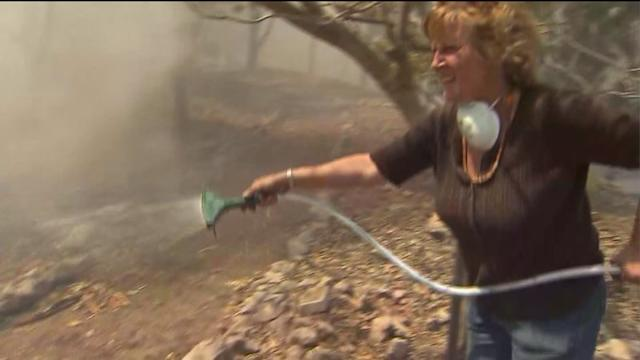 Frightened Residents Fight to Protect Their Homes From Wildfire