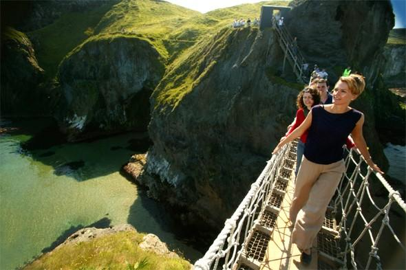 "<p>Beautiful <a href=""http://www.walkni.com/walks/386/carrick-a-rede/"" target=""_blank"">Carrick-a-Rede Island</a> in County Antrim is famous for its rope bridge, which connects the mainland and the island. Until recently, it was an active salmon fishery but it now attracts visitors looking to experience its exhilarating coastal path and rope bridge from the cliffs to the rocky island, with breathtaking views of Rathlin and the Scottish Isles. Summer is the most delightful time to visit when the grassy slopes before the island are awash with colour. <strong>Best for: A fun, short walk for all.</strong></p>"