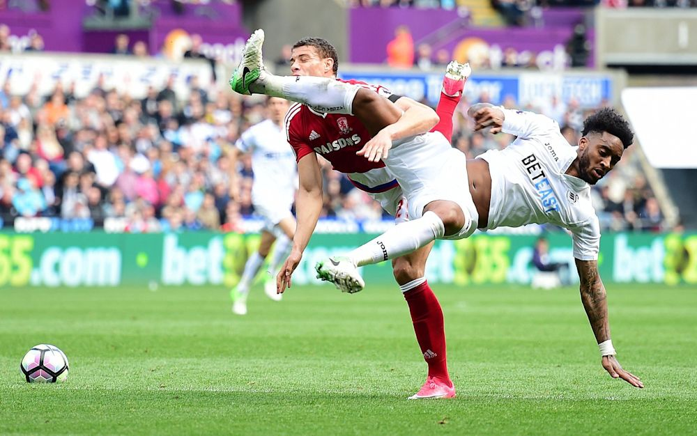 Leroy Fer battles for a high ball with Rudy Gestede - Rex Features