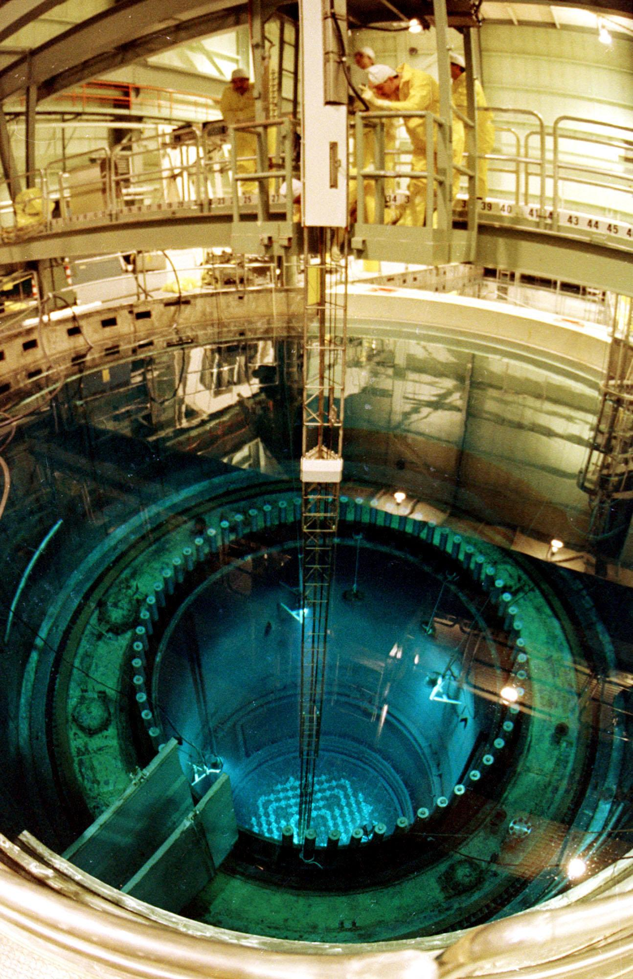 FILE - In this Dec.1985 file photo, workers perform maintenance on the reactor vessel at the Vermont Yankee nuclear power plant in Vernon, Vt. Vermont's only nuclear power plant will shut down by the end of 2014, ending a nasty legal battle over the future of the 4-decade-old plant, Entergy Corp. announced Tuesday, Aug. 27, 2013. The Vermont Yankee Nuclear Power Station is expected to cease power production after its current fuel cycle and will begin being decommissioned in the fourth quarter of 2014, the company said.(AP Photo/Toby Talbot, File)