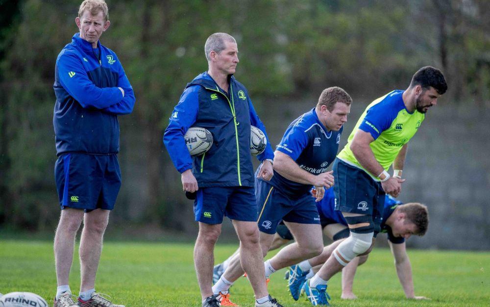 Stuart Lancaster (centre) puts the Leinster players through their paces - Rex Features