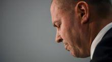 Coalition cuts forecast surplus as budget update reveals economic slump