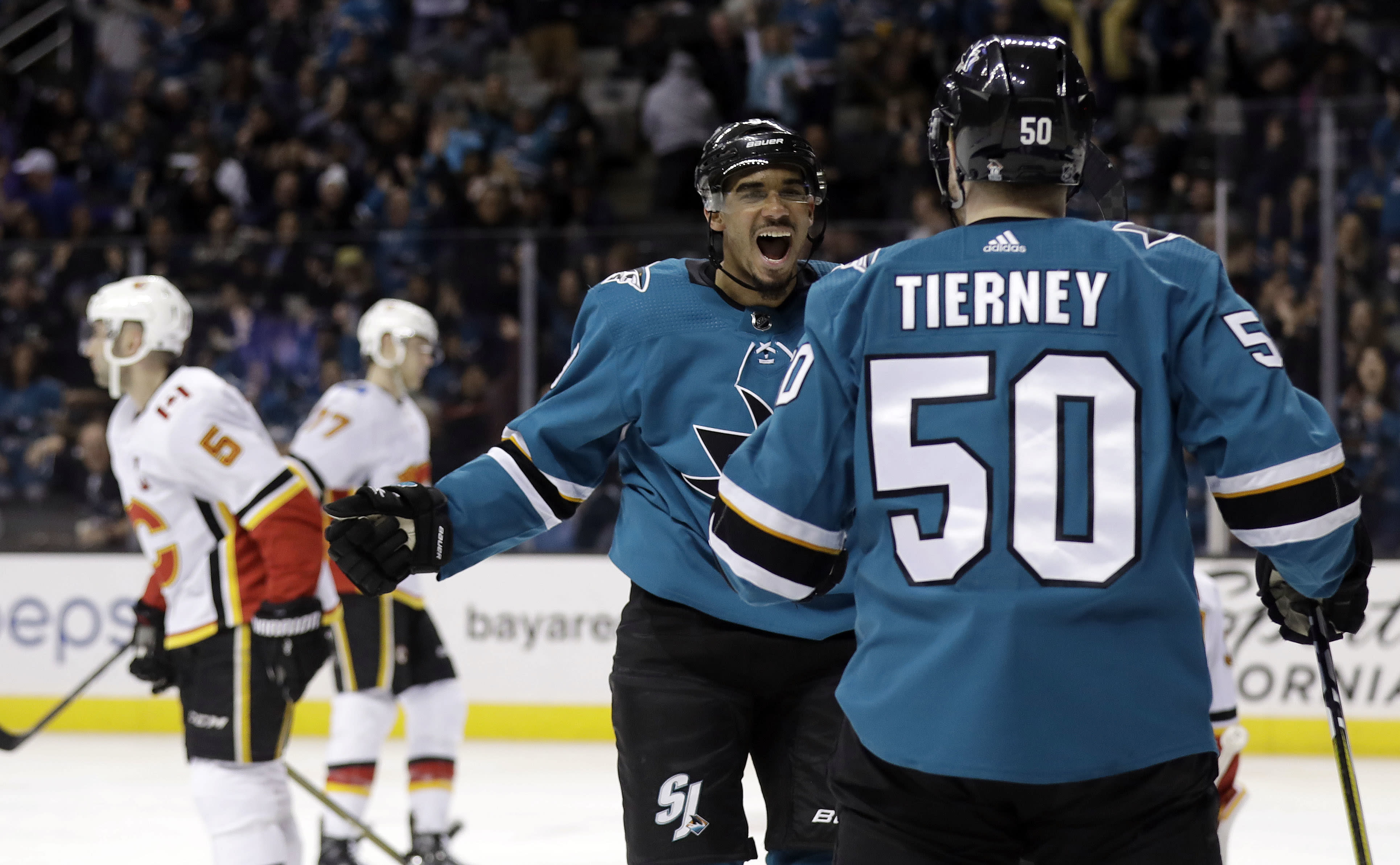 Kane scores twice to lead streaking Sharks past Flames 5-1
