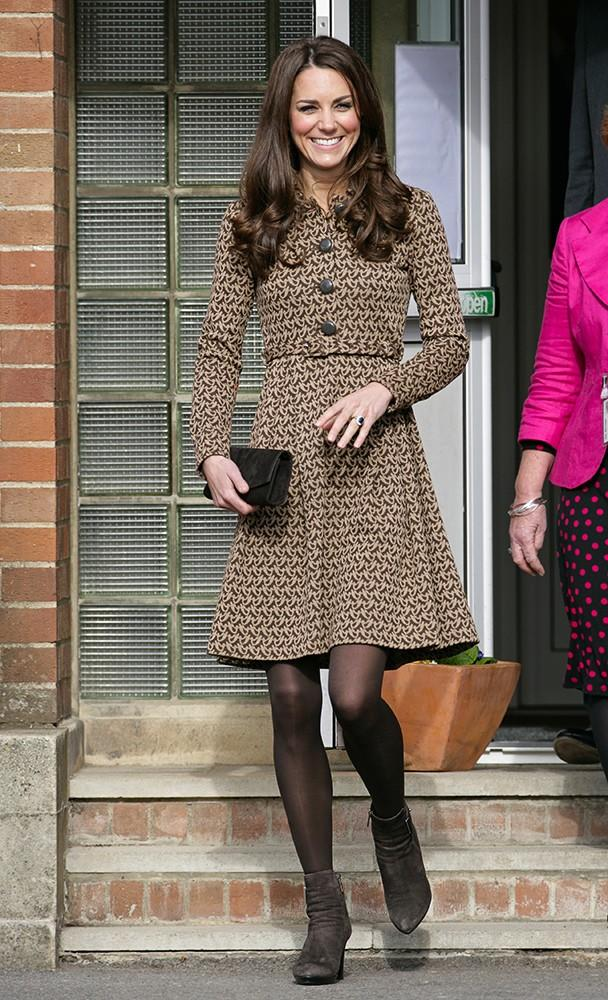 Kate visited schools in Oxford, wearing a flared, bird-print Orla Kiely dress.