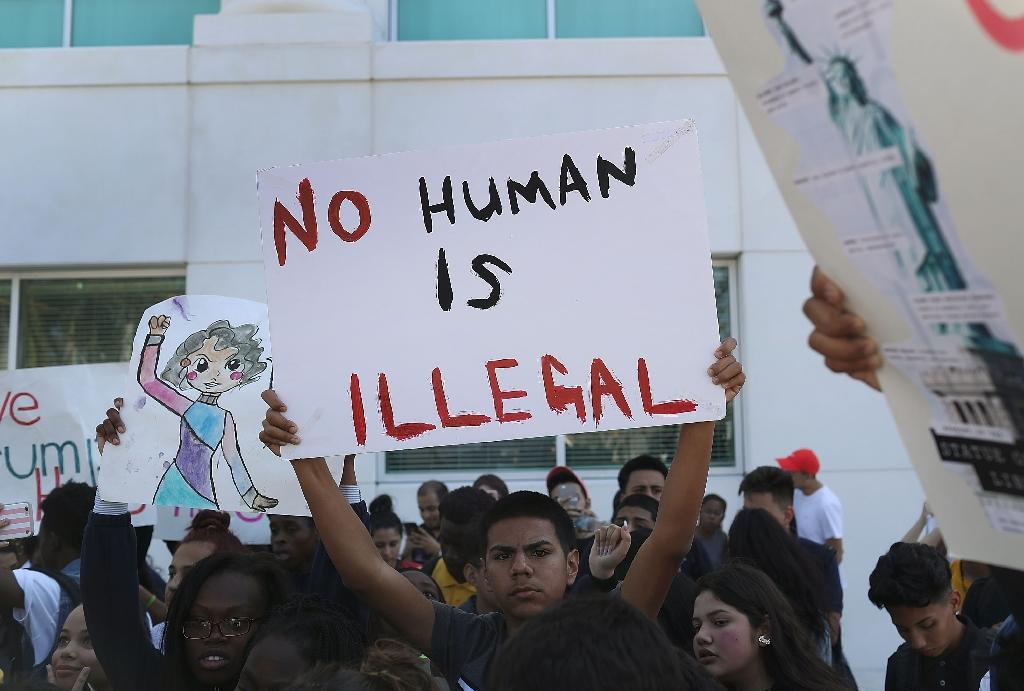 Advocates say protecting undocumented immigrants from deportation and other punishments encourages them to report crimes, enroll in school and seek healthcare (AFP Photo/JOE RAEDLE)