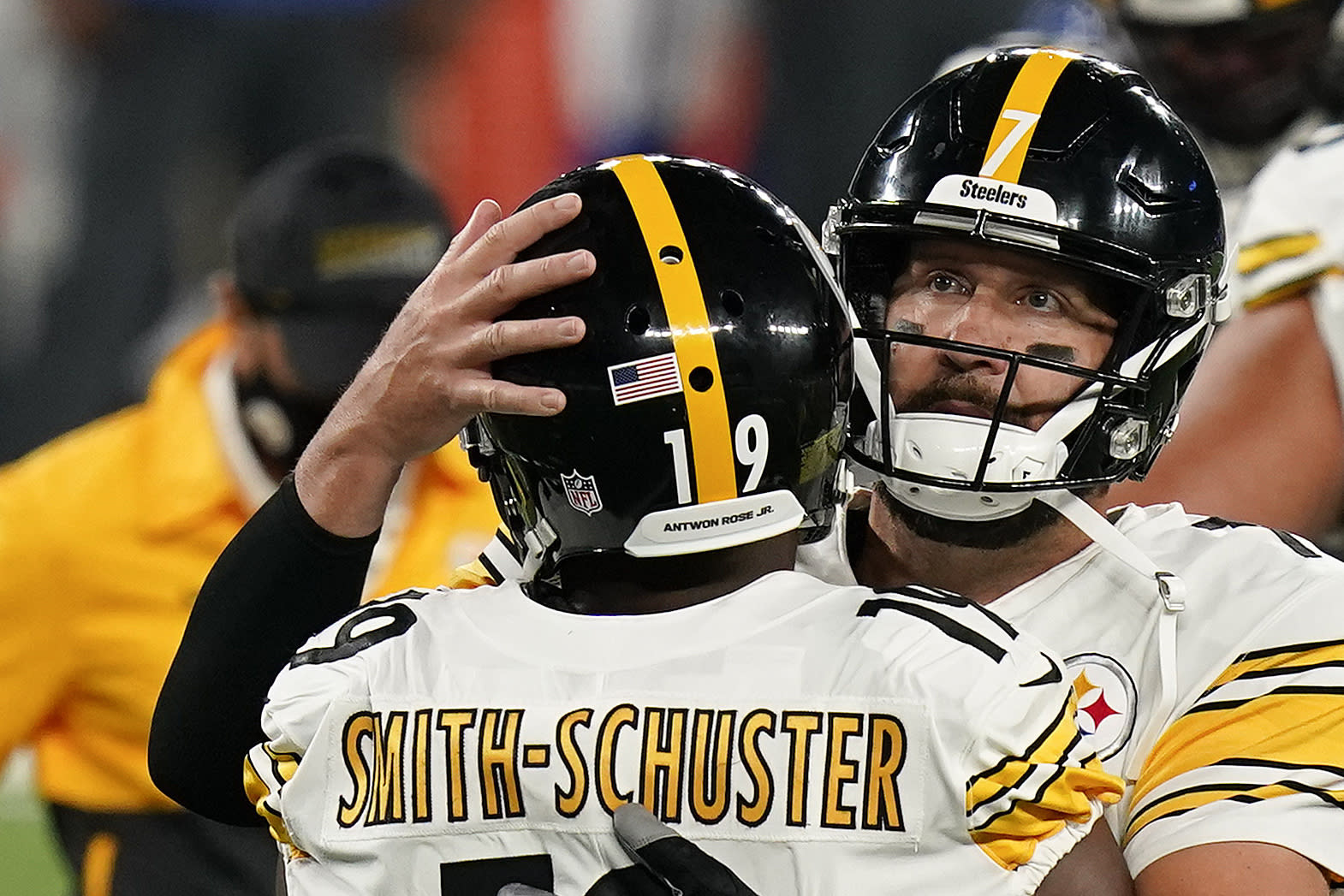 FILE - Pittsburgh Steelers wide receiver JuJu Smith-Schuster (19) celebrates with Pittsburgh Steelers quarterback Ben Roethlisberger (7) after scoring a touchdown against the New York Giants during the fourth quarter of an NFL football game Monday, Sept. 14, 2020, in East Rutherford, N.J. The name Antwon Rose Jr., a Black Pittsburgh teenager shot in the back and killed by a white police officer in 2018, has his name on a white strip on the back of most Steelers helmets, (AP Photo/Seth Wenig, File)
