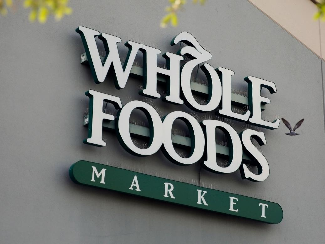 Whole Foods, which is owned by Amazon, has boosted wages for U.S. workers and promised two weeks of paid leave for employees diagnosed with coronavirus or those made to quarantine.