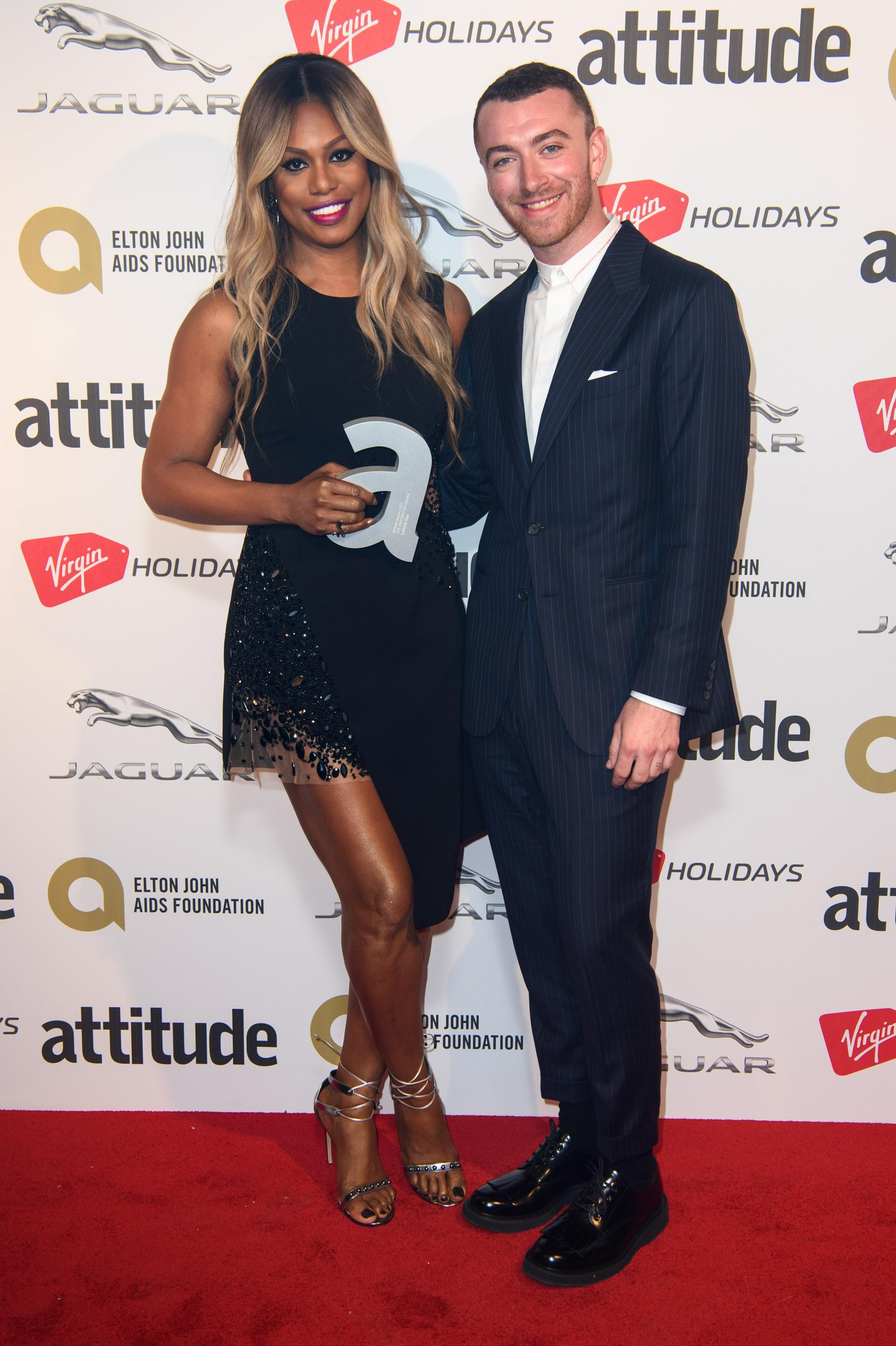 Laverne Cox pictured with presenter Sam Smith backstage at the Attitude Awards, where she won won the Inspiration award, at the Roundhouse in North London. Picture date: Thursday October 12th, 2017. Photo credit should read: Matt Crossick/ EMPICS Entertainment.
