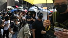 Democracy crowds defy Hong Kong police after activists attacked