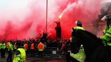 Liverpool fan 'assaulted by Roma supporters wielding belts as weapons' outside Anfield