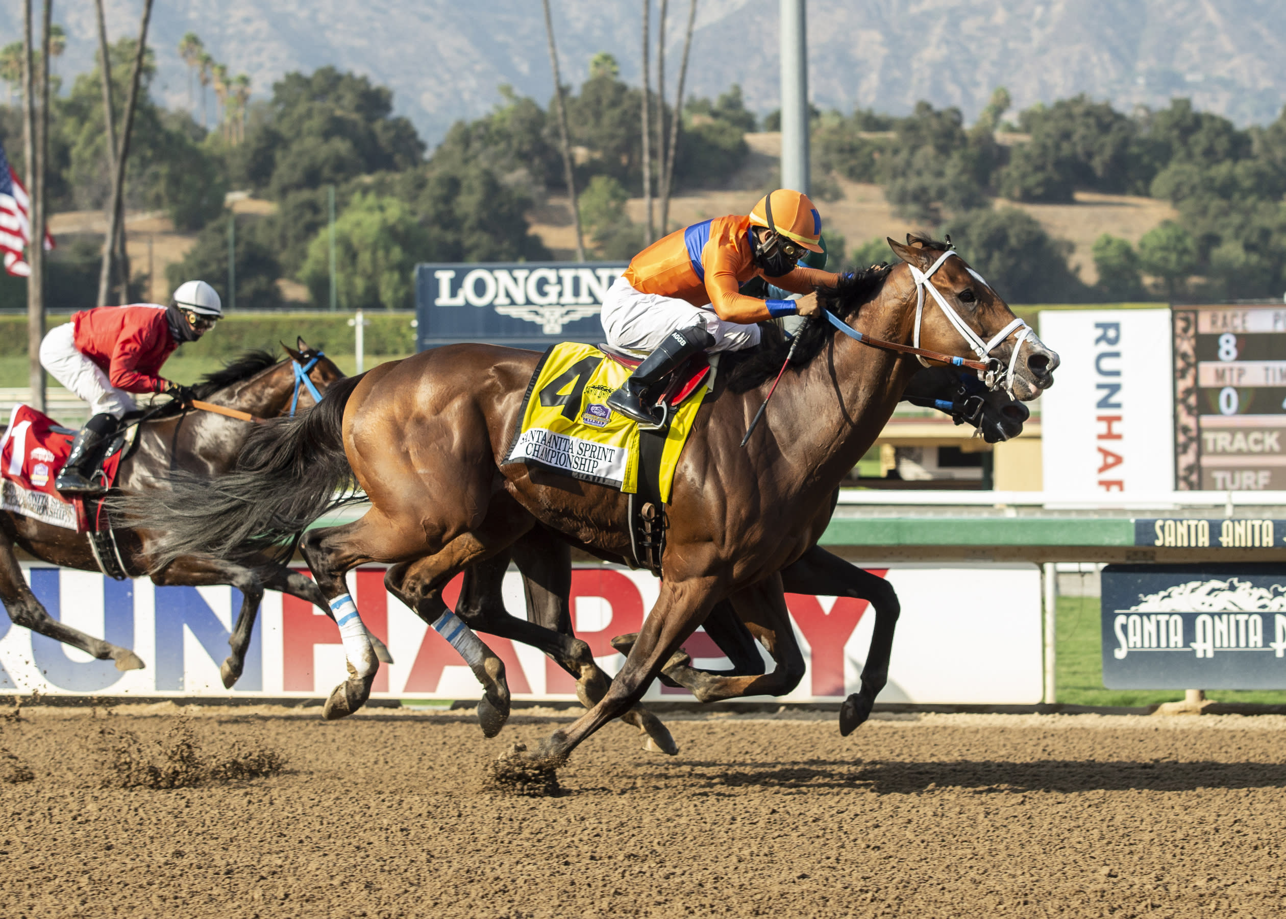 In a photo provided by Benoit Photo, C Z Rocket and jockey Luis Saez, outside, overpower Flagstaff (Victor Espinoza), inside, and Collusion Illusion (Flavien Prat), left, to win the Grade II, $200,000 Santa Anita Sprint Championship, Sunday, Sept. 27, 2020 at Santa Anita Park in Arcadia Calif.(Benoit Photo via AP)